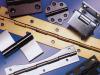 Scharnieren, draadvormen, schuifgeleiders, brackets, ...